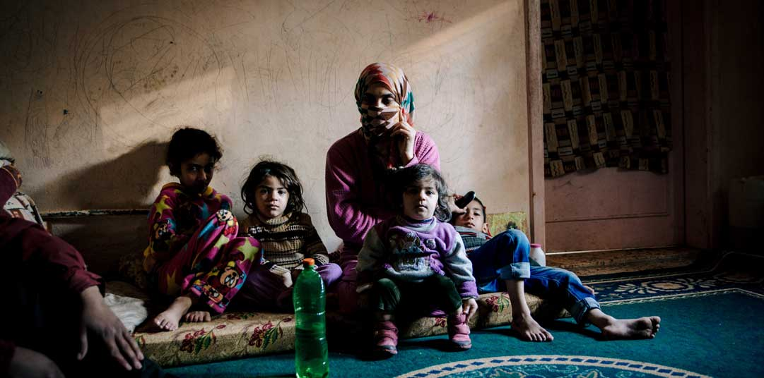 Reema with her children in their apartment in Ramtha, Jordan